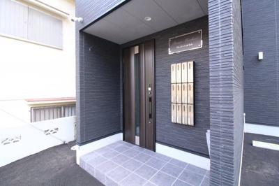 【エントランス】プレジール妙法寺
