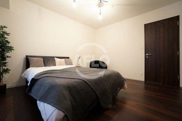 夕陽ヶ丘リバーガーデン 清潔感のある寝室