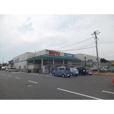 スーパー「西友高田店まで1124m」