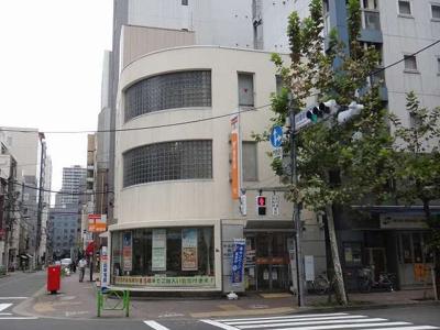 中央新富二郵便局まで477m